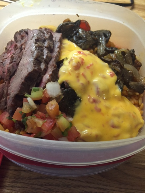 Burrito bowls times two - an easy reheatable weekday lunch from our weekend fajita feast.